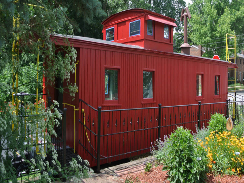 Photo of the restored caboose on the campus of the History Center